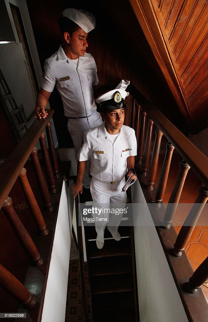 Brazilian Navy sailors inspect a home whle passing out pamphlets warning of the dangers of the Zika virus and how to protect against mosquitos on February 13, 2016 in Rio de Janeiro, Brazil. 220,000 Brazilian military troops were deployed today in a mobilization across country to warn of the dangers of the mosquito-borne virus which may be linked to microcephaly.