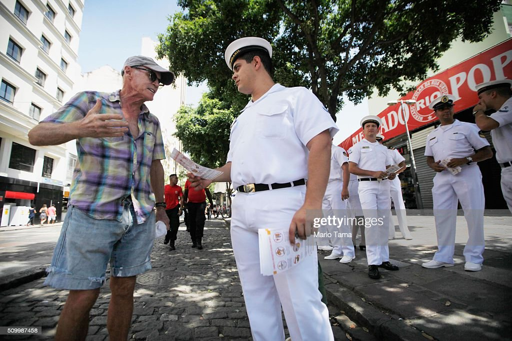 Brazilian Navy sailors stands and pass out pamphlets warning of the dangers of the Zika virus and how to protect against mosquitos on February 13, 2016 in Rio de Janeiro, Brazil. 220,000 Brazilian military troops were deployed today in a mobilization across country to warn of the dangers of the mosquito-borne virus which may be linked to microcephaly.