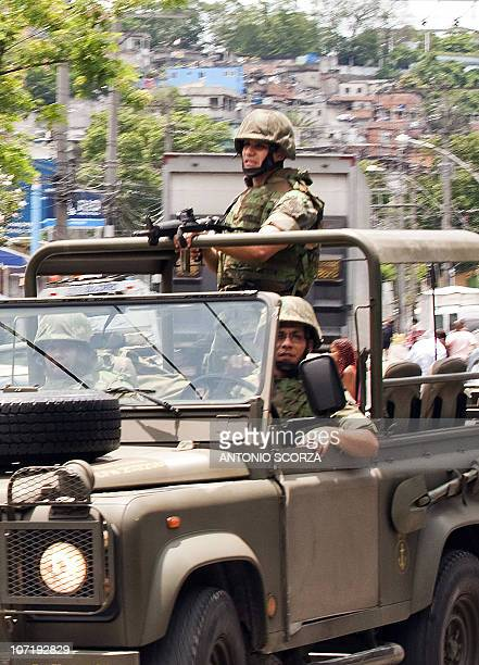 Brazilian Navy soldiers patrol a street of Vila Cruzeiro shantytown on November 29 2010 in Rio de Janeiro BrazilBrazilian law enforcement agencies...