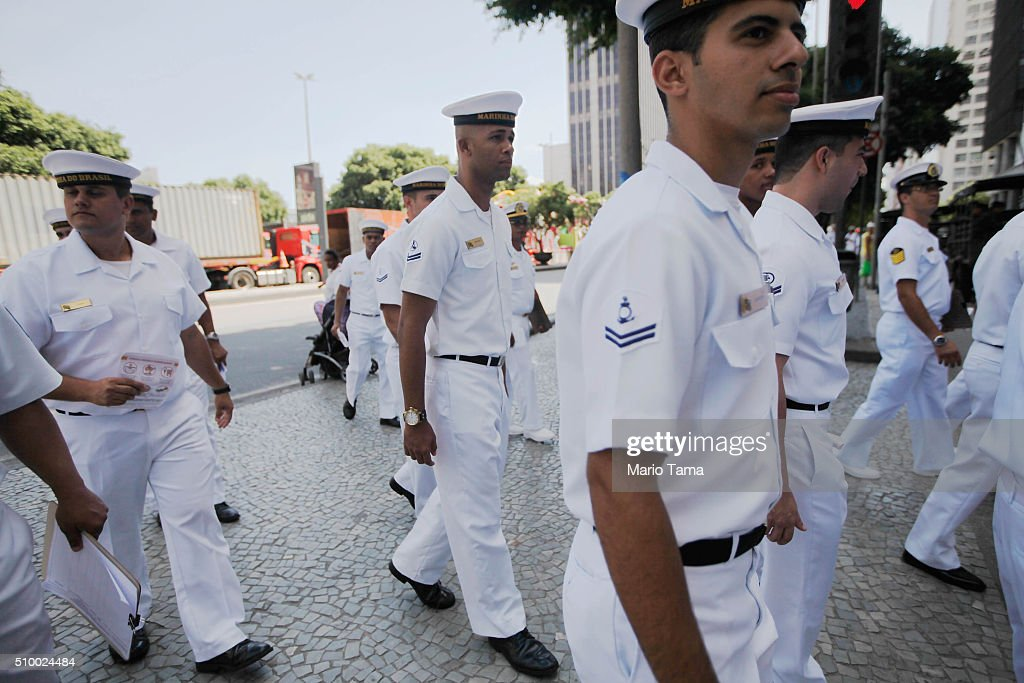 Brazilian Navy walk after passing out pamphlets warning of the dangers of the Zika virus and how to protect against mosquitos on February 13, 2016 in Rio de Janeiro, Brazil. 220,000 Brazilian military troops were deployed today in a mobilization across country to warn of the dangers of the mosquito-borne virus which may be linked to microcephaly.