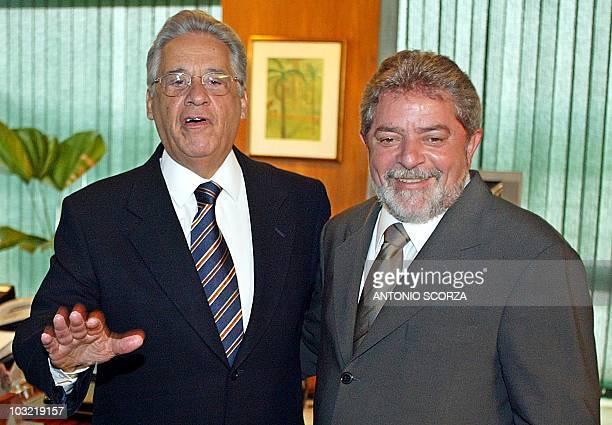Brazilian newly elected president Luiz Inacio Lula da Silva smiles as ruling president Fernando Henrique Cardoso jokes with the photographers 29...