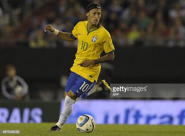 Brazilian Neymar constrols the ball during the Russia 2018 FIFA World Cup South American Qualifiers football match against Argentina in Buenos Aires...