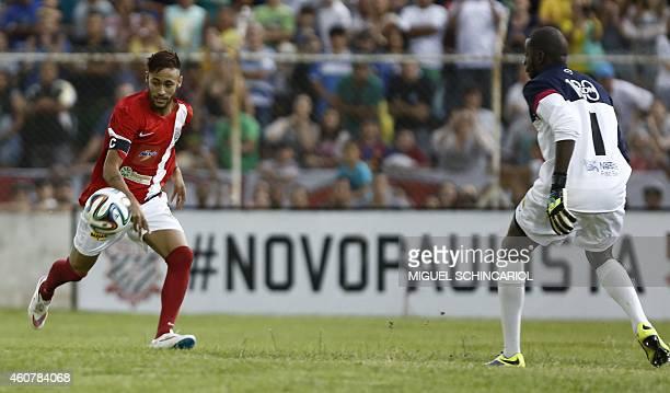 Brazilian Neymar of Spanish team Barcelona controls the ball during the charity football match 'Ball Hunger Only' at Jaime Cintra stadium in Jundiai...