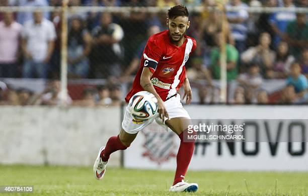 Brazilian Neymar of Spanish team Barcelona takes part in the charity football match 'Ball Hunger Only' at Jaime Cintra stadium in Jundiai in Sao...