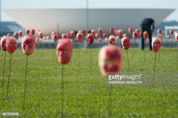Brazilian NGO Rio de Paz stages a protest against political corruption scandals placing 595 masks one of each congressman and one for President...