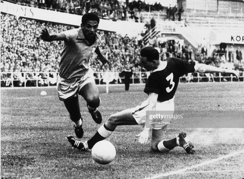 Brazilian outside right <a gi-track='captionPersonalityLinkClicked' href=/galleries/search?phrase=Garrincha&family=editorial&specificpeople=939039 ng-click='$event.stopPropagation()'>Garrincha</a> and Welsh player Hopkins fight for possession of the ball during the World Cup quarter final at Gothenburg in Sweden. Brazil won by 1 goal to nil, thus assuring their place in the semi-finals.