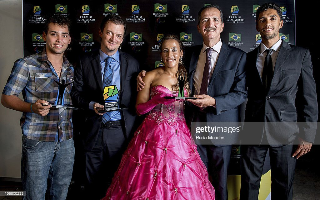 Brazilian paralympic Alan Fonteles, President of the Brazilian Paralympic Committee, Andrew Parsons, Terezinha Guilhermina, Sports Minister Aldo Rebelo and athlete guide Guilherme Santana pose for a photo during the ceremony of Brazil Paralympics Award 2012 at the Marina da Gloria on December 19, 2012 in Rio de Janeiro, Brazil.