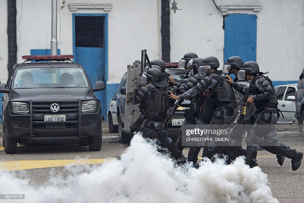 Brazilian paramilitary police CHOQUE batallion personnel in riot gear drill at the general police headquarters in Rio de Janeiro, Brazil on March 15, 2013, part of the security measures ahead of the Confederation Cup which will be held next June for the 2014 FIFA World Cup and 2016 Olympics Games.