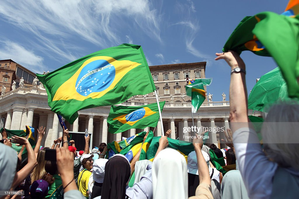 Brazilian pilgrims gathered in St Peter's Square attend the Sunday Angelus blessing held by Pope Francis on July 21, 2013 in Vatican City, Vatican. On the eve of his departure to Brazil for the World Youth Day celebrations in Rio de Janeiro, Pope Francis from the window of the apostolic palace asked those present in St Peter's Square to accompany him spiritually in prayer for this his first pastoral visit.