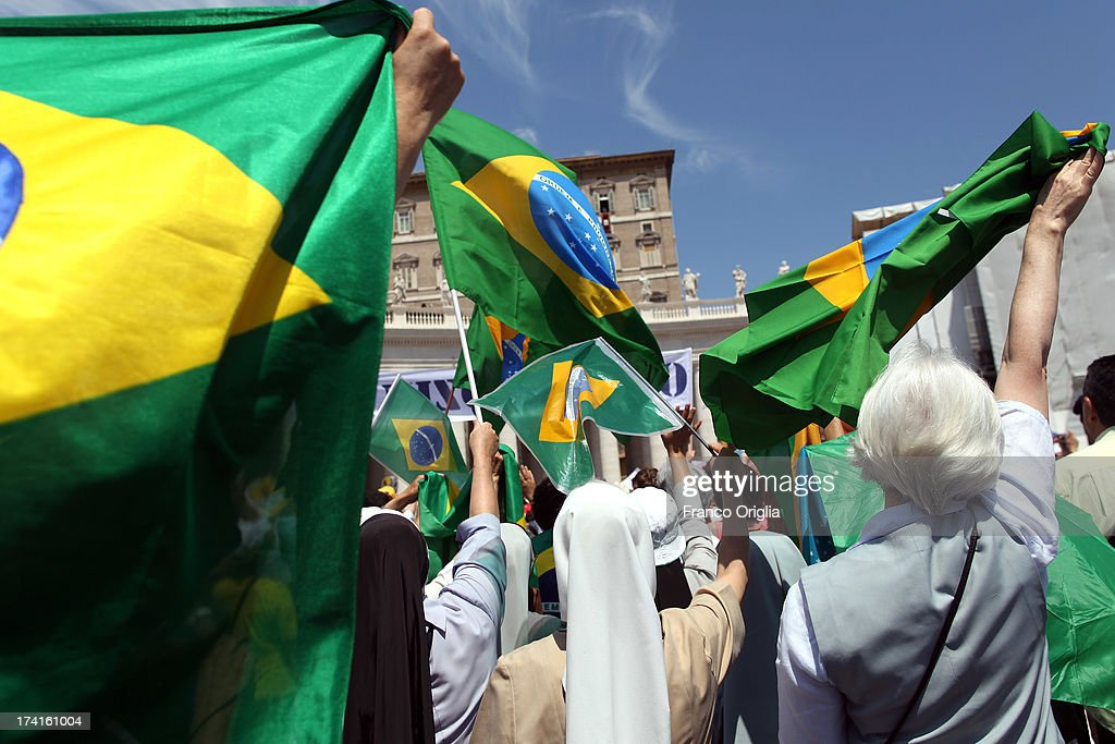 Brazilian pilgrims gathered in St Peter's Square attend the Sunday Angelus blessing held by Pope Francis on July 21, 2013 in Vatican City, Vatican. On the eve of his departure to Brazil for the World Youth Day celebrations in Rio de Janeiro, Pope Francis asked those present in St Peter's Square to accompany him in prayer for his first pastoral visit.