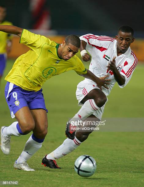 Brazilian player Adriano fights for the ball with UAE player Basheer Saeed during their friendly match for the World Cup 2006 in Abu Dhabi 12...