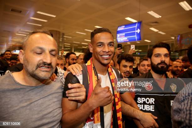 Brazilian player Fernando Francisco Reges is welcomed by fans of Galatasaray as he arrives at Ataturk Airport to sign a contract with Galatasaray in...