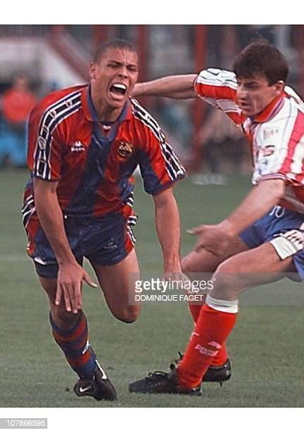 Brazilian player Luis Nazario de Lima Ronaldo of F C Barcelona fights for the ball with Prodan of the Atletico Madrid during the Spanish soccer...
