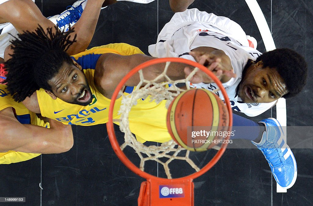 Brazilian player Nene Hilario (L) vies with France's player Mickael Gelabale, during the basketball match France vs Brazil, in Strasbourg, eastern France, on July 21, 2012 as part of the preparation for the London 2012 Olympics.
