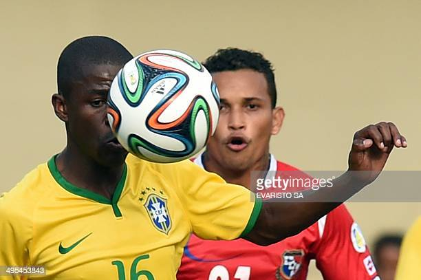 Brazilian player Ramires controls the ball next to Panamanian Amilcar Henriquez during a friendly match as preparation for FIFA World Cup Brazil 2014...