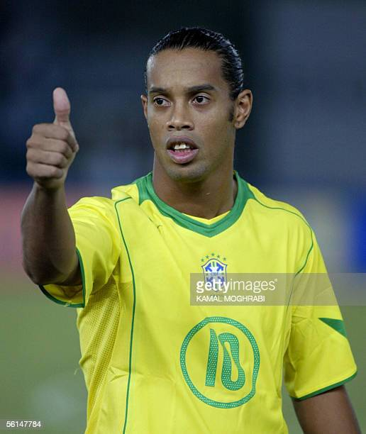 Brazilian player Ronaldinho Gaucho gives a thumbs up sign before their friendly match against UAE for the World Cup 2006 in Abu Dhabi 12 November...