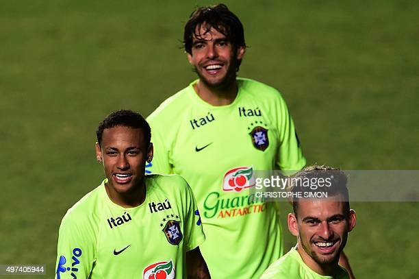 Brazilian players Neymar Junior Kaka and Douglas Costa take part in a training session in Salvador Brazil on November 16 on the eve of a FIFA World...