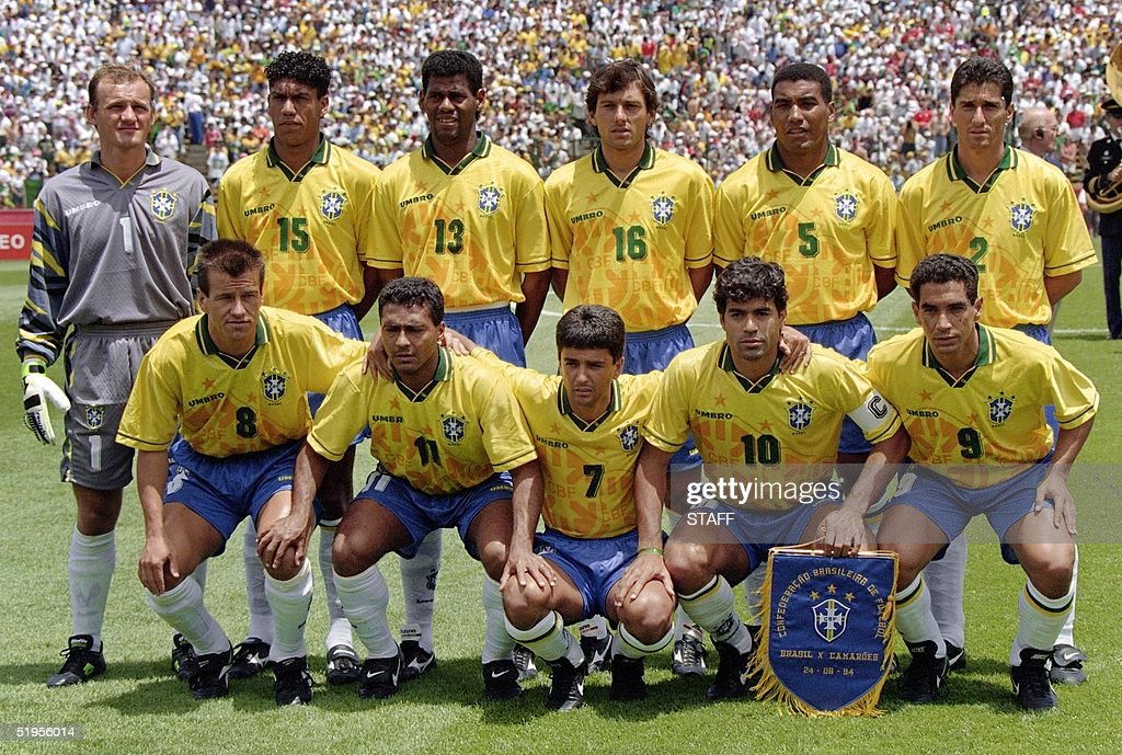 Brazilian players pose for the team picture before their World Cup first round soccer match against Cameroon 24 June 1994 in Stanford Standing from L...