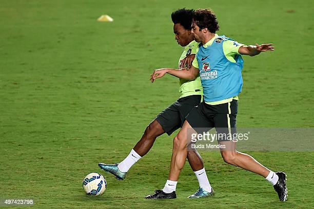 Brazilian players Willian and Kaka take part in a training session at the Pituaçu stadium on the eve of the 2018 FIFA World Cup Russia Qualifiers...