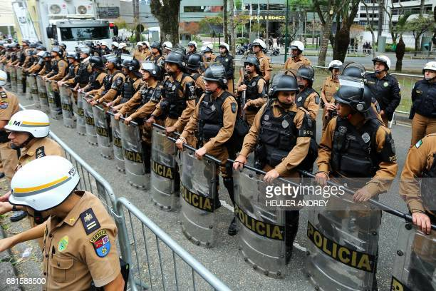 Brazilian police stand guard outside a Federal Justice Court in Curitiba southern Brazil where former president Luiz Inacio Lula da Silva will arrive...