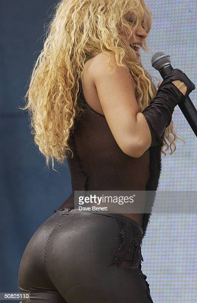 Brazilian pop star Shakira performs on stage at the Prince's Trust 'Party in the Park 2002' in Hyde Park on July 7 2002 in London