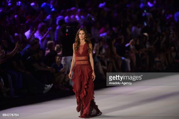 Brazilian pregnant top model Izabel Goulart walks the runway during the Dosso Dossi Fashion Show in Antalya Turkey on June 09 2017