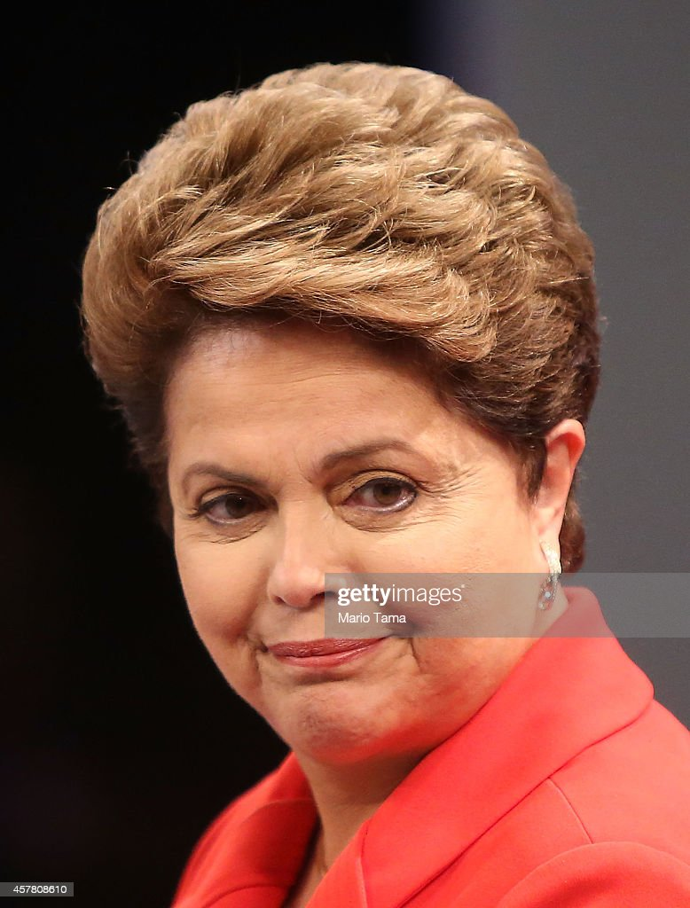 Brazilian President and Workers' Party (PT) candidate Dilma Rousseff (R) smiles at the audience prior to the debate with Presidential candidate of the Brazilian Social Democratic Party (PSDB) Aecio Neves on October 24, 2014 in Rio de Janeiro, Brazil. The two are squaring off in a run-off election on October 26.