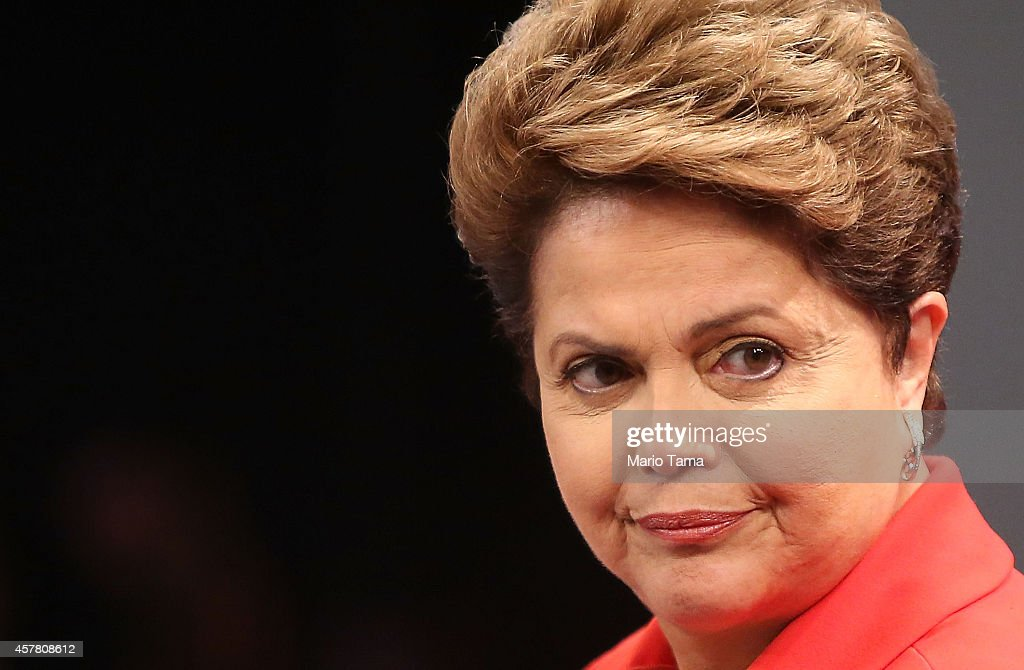 Brazilian President and Workers' Party (PT) candidate Dilma Rousseff (R) waves to the audience prior to the debate with Presidential candidate of the Brazilian Social Democratic Party (PSDB) Aecio Neves on October 24, 2014 in Rio de Janeiro, Brazil. The two are squaring off in a run-off election on October 26.