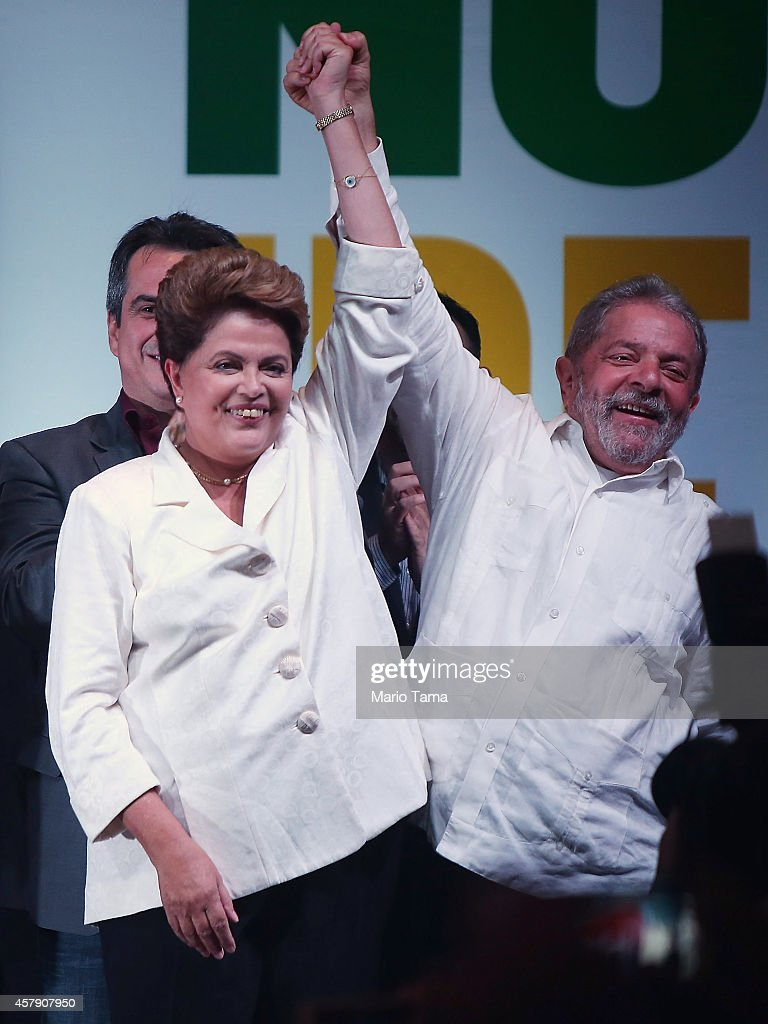 Brazilian President and Workers' Party (PT) candidate <a gi-track='captionPersonalityLinkClicked' href=/galleries/search?phrase=Dilma+Rousseff&family=editorial&specificpeople=1955968 ng-click='$event.stopPropagation()'>Dilma Rousseff</a> (L) celebrates with Brazil's former president Luiz Inacio Lula Da Silva (R) after being re-elected on October 26, 2014 in Brasilia, Brazil. Rousseff defated Presidential candidate of the Brazilian Social Democratic Party (PSDB) Aecio Neves in a run-off election today.