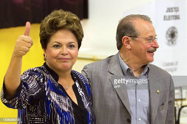 Brazilian President Dilma Rousseff accompanied by the governor of the southern Brazilian state of Rio Grande do Sul Tarso Genro gives her thumb up...