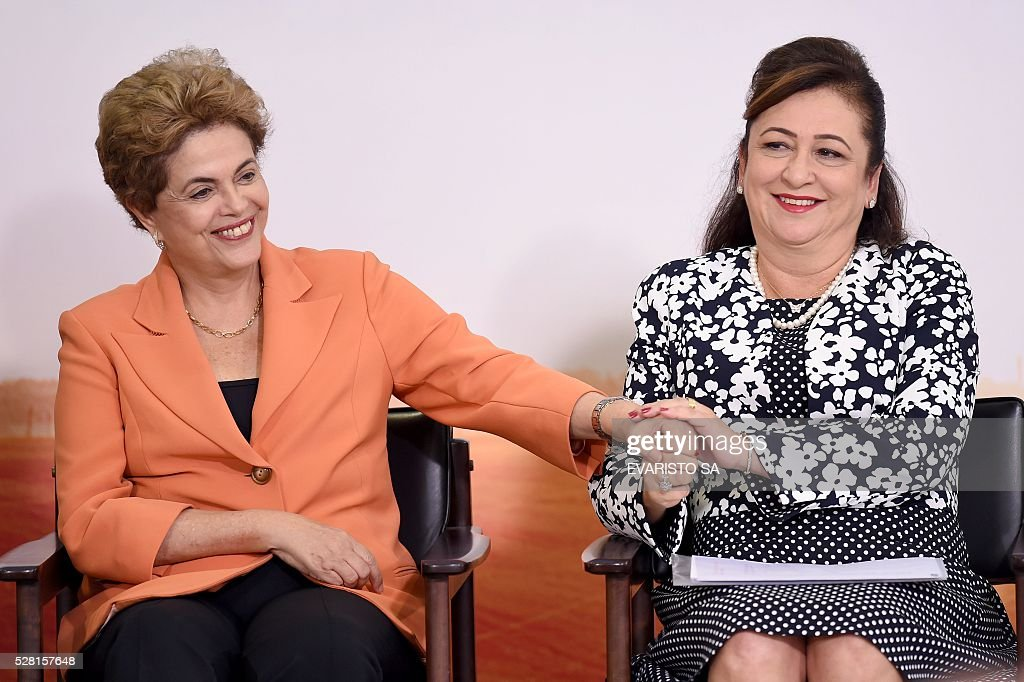 Brazilian President Dilma Rousseff (L) and Agriculture Minister Katia Abreu attend the launching of the Agricultural and Livestock Plan for 2016/2017, at Planalto Palace in Brasilia, on May 4, 2016. Rousseff is fighting impeachment on allegations that she illegally borrowed money to boost public spending during her 2014 re-election campaign. / AFP / EVARISTO SA