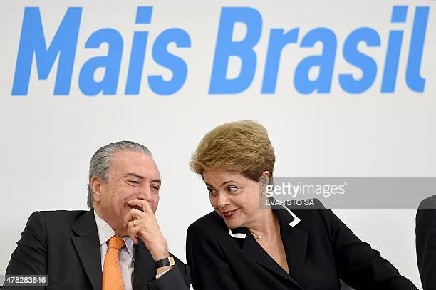 Brazilian President Dilma Rousseff and her vice President Michel Temer talk during the launching of the National Plan for Export which aims at...