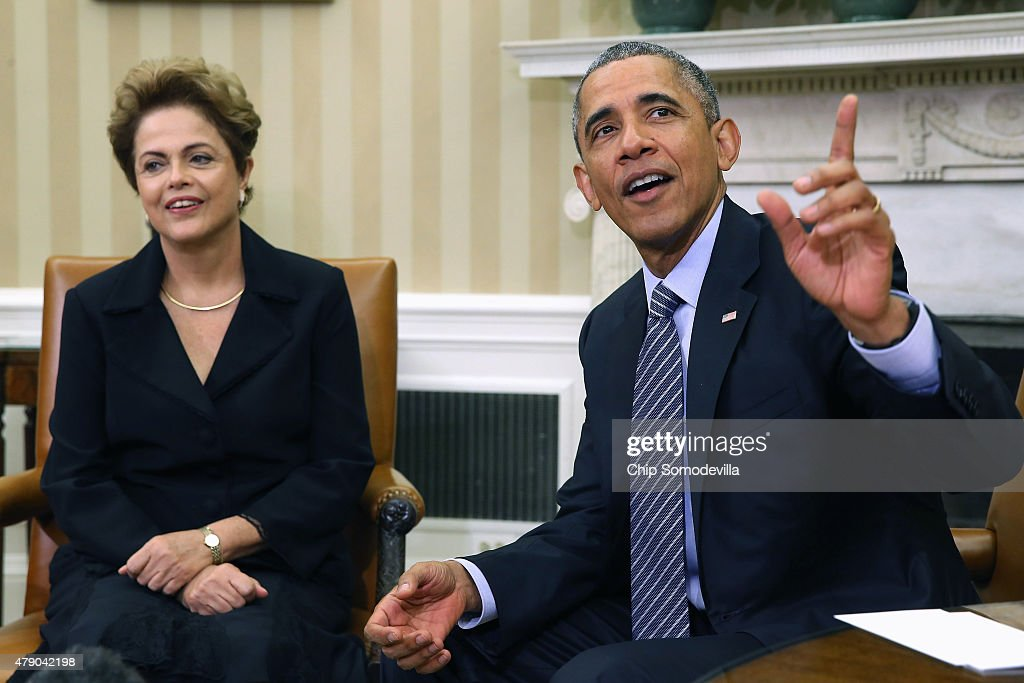 Brazilian President Dilma Rousseff (L) and U.S. President Barack Obama pose for photographs in the Oval Office at the White House June 30, 2015 in Washington, DC. Rousseff and Obama held meetings and a joint press conference almost two years after Rousseff accepted but then skipped an invitation to the White House due to revelations from former NSA contractor Edward Snowden that the U.S. had spied on Rousseff and other Brazilians.