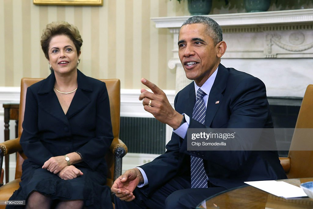 Brazilian President <a gi-track='captionPersonalityLinkClicked' href=/galleries/search?phrase=Dilma+Rousseff&family=editorial&specificpeople=1955968 ng-click='$event.stopPropagation()'>Dilma Rousseff</a> (L) and U.S. President <a gi-track='captionPersonalityLinkClicked' href=/galleries/search?phrase=Barack+Obama&family=editorial&specificpeople=203260 ng-click='$event.stopPropagation()'>Barack Obama</a> pose for photographs in the Oval Office at the White House June 30, 2015 in Washington, DC. Rousseff and Obama held meetings and a joint press conference almost two years after Rousseff accepted but then skipped an invitation to the White House due to revelations from former NSA contractor Edward Snowden that the U.S. had spied on Rousseff and other Brazilians.