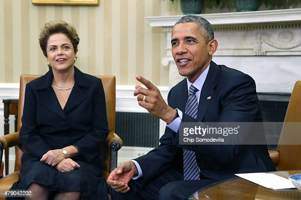 Brazilian President Dilma Rousseff and US President Barack Obama pose for photographs in the Oval Office at the White House June 30 2015 in...