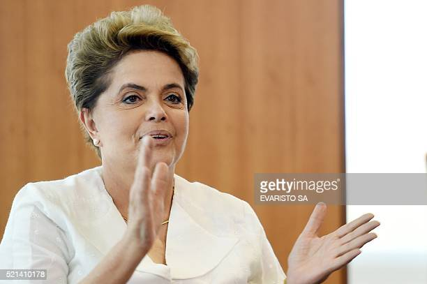 Brazilian President Dilma Rousseff applauds during a meeting with the Organization of American States Secretary General Luis Almagro at Planalto...