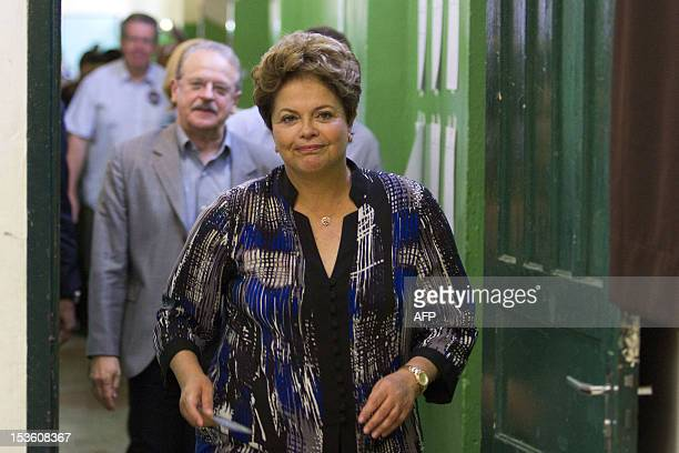 Brazilian President Dilma Rousseff arrives at a polling station in Porto Alegre in the southern Brazilian state of Rio Grande do Sul during...
