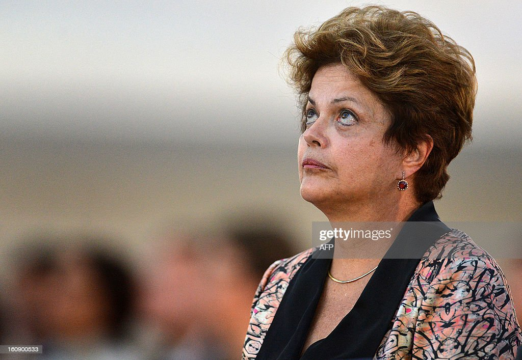Brazilian president Dilma Rousseff attends an ecumenical service for the 238 victims of the Kiss nightclub fire in Santa Maria, southern Brazil, days ago, at Brasilia's Metropolitan Cathedral, in Brasilia on February 07, 2013. AFP PHOTO/Pedro LADEIRA