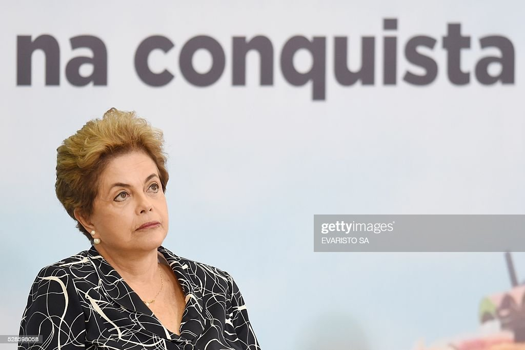 Brazilian President Dilma Rousseff attends the launching ceremony of a new stage of the state-subsidized housing program at Planalto Palace in Brasilia on May 6, 2016. A special committee in Brazil's Senate was to vote Friday on whether to recommend starting an impeachment trial against President Dilma Rousseff who faces being suspended from office in less than a week. / AFP / EVARISTO SA