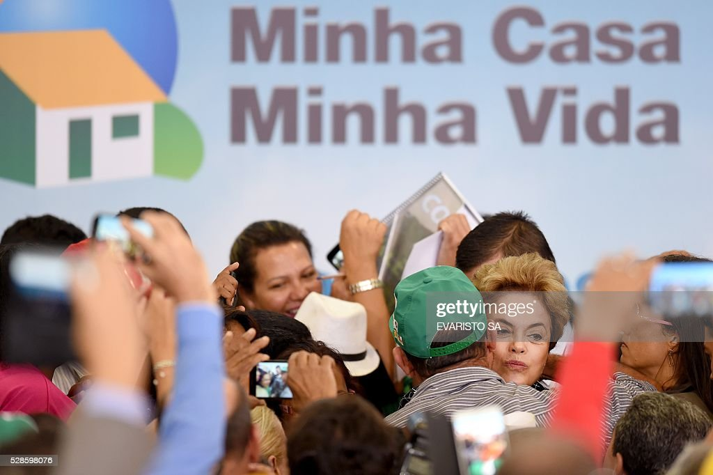 Brazilian President Dilma Rousseff (C-R) attends the launching ceremony of a new stage of the state-subsidized housing program at Planalto Palace in Brasilia on May 6, 2016. A special committee in Brazil's Senate was to vote Friday on whether to recommend starting an impeachment trial against President Dilma Rousseff who faces being suspended from office in less than a week. / AFP / EVARISTO SA