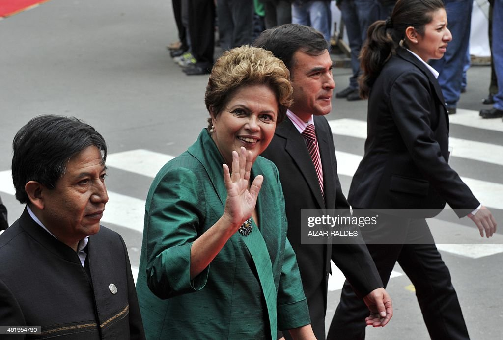 Brazilian President <a gi-track='captionPersonalityLinkClicked' href=/galleries/search?phrase=Dilma+Rousseff&family=editorial&specificpeople=1955968 ng-click='$event.stopPropagation()'>Dilma Rousseff</a> (C), Bolivian Foreign Minister <a gi-track='captionPersonalityLinkClicked' href=/galleries/search?phrase=David+Choquehuanca&family=editorial&specificpeople=589843 ng-click='$event.stopPropagation()'>David Choquehuanca</a> (L), and Bolivian Minister of the Presidency, Juan Ramon Quintana (2-R) arrive at the National Congress in La Paz, for the swearing-in ceremony of Bolivian reelected President <a gi-track='captionPersonalityLinkClicked' href=/galleries/search?phrase=Evo+Morales&family=editorial&specificpeople=272981 ng-click='$event.stopPropagation()'>Evo Morales</a> for a third mandate, on January 22, 2015. Morales, Bolivia's first indigenous president, took the oath of office with his left fist raised 'on behalf of the Bolivian people and equality for all human beings.' The 55-year-old former coca grower, in office since 2006, was re-elected in October with 61 percent of the vote. His new terms ends in 2020.