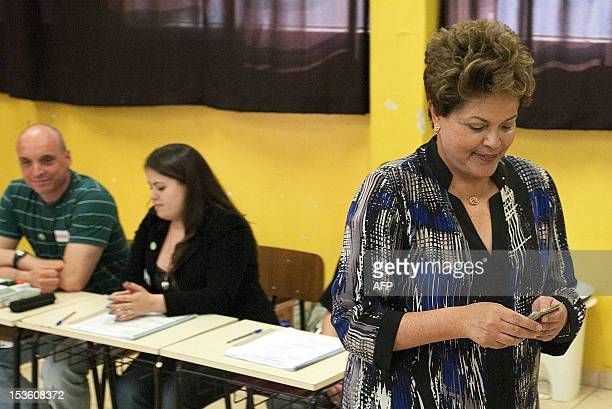 Brazilian President Dilma Rousseff casts her vote at a polling station in Porto Alegre in the southern Brazilian state of Rio Grande do Sul during...
