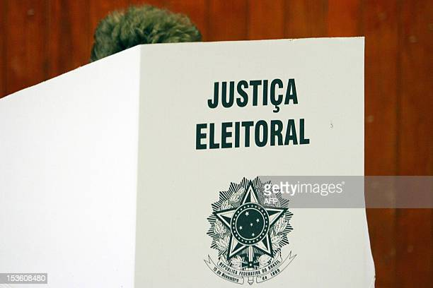 Brazilian President Dilma Rousseff casts her vote at a polling station in Porto Alegre during nationawide municipal elections on October 7 2012...