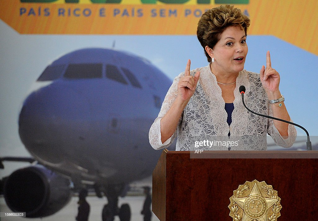 Brazilian President Dilma Rousseff delivers a speech during a ceremony to announce investments in airports in Brazil, at Planalto Palace, in Brasilia, on December 20, 2012. Brazilian government plans a 18 billion Reales (about 9 billion dollars) investment in Brazilian airports --including those in small towns-- to face necessary logistics for the upcoming 2014 FIFA World Cup and the 2016 Olympic Games. AFP PHOTO/Pedro LADEIRA