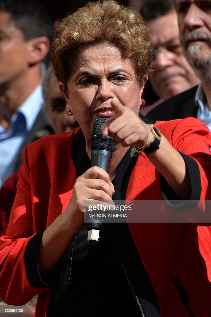 Brazilian President Dilma Rousseff delivers a speech during a demonstration to mark International Workers' Day, in Sao Paulo, Brazil, on May 1, 2016. / AFP / NELSON