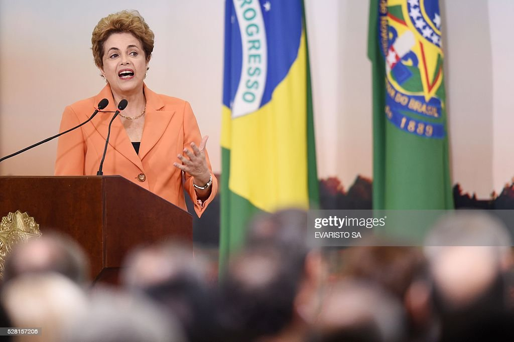 Brazilian President Dilma Rousseff delivers a speech during the launching of the Agricultural and Livestock Plan for 2016/2017, at Planalto Palace in Brasilia, on May 4, 2016. Rousseff is fighting impeachment on allegations that she illegally borrowed money to boost public spending during her 2014 re-election campaign. / AFP / EVARISTO SA