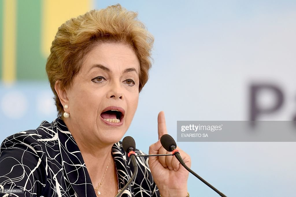 Brazilian President Dilma Rousseff delivers a speech during the launching ceremony of a new stage of the state-subsidized housing program at Planalto Palace in Brasilia on May 6, 2016. A special committee in Brazil's Senate was to vote Friday on whether to recommend starting an impeachment trial against President Dilma Rousseff who faces being suspended from office in less than a week. / AFP / EVARISTO SA