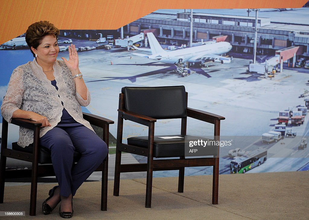 Brazilian President Dilma Rousseff gestures during a ceremony to announce investments in airports in Brazil, at Planalto Palace, in Brasilia, on December 20, 2012. Brazilian government plans a 18 billion Reales (about 9 billion dollars) investment in Brazilian airports --including those in small towns-- to face necessary logistics for the upcoming 2014 FIFA World Cup and the 2016 Olympic Games. AFP PHOTO/Pedro LADEIRA