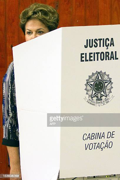 Brazilian President Dilma Rousseff is pictured as she casts her vote during nationawide municipal elections in Porto Alegre southern Brazil on...