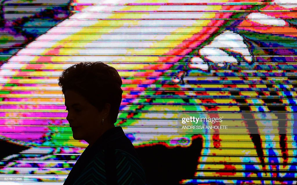 Brazilian President Dilma Rousseff is pictured during the ceremony to receive the Olympic Flame at Planalto Palace in Brasilia following it's arrival in Brazil on May 3, 2016 ahead of the Rio 2016 Olympic Games in August. The Olympic flame arrived in Brasilia May 3 aboard a flight from Geneva to embark on a procession across Brazil culminating in the opening ceremony of the 2016 Games in Rio de Janeiro. The torch will travel to more than 300 towns and cities carried by some 12,000 relay runners before arriving August 5 at the mythic Maracana stadium to kick off the first Olympics in South America. / AFP / ANDRESSA